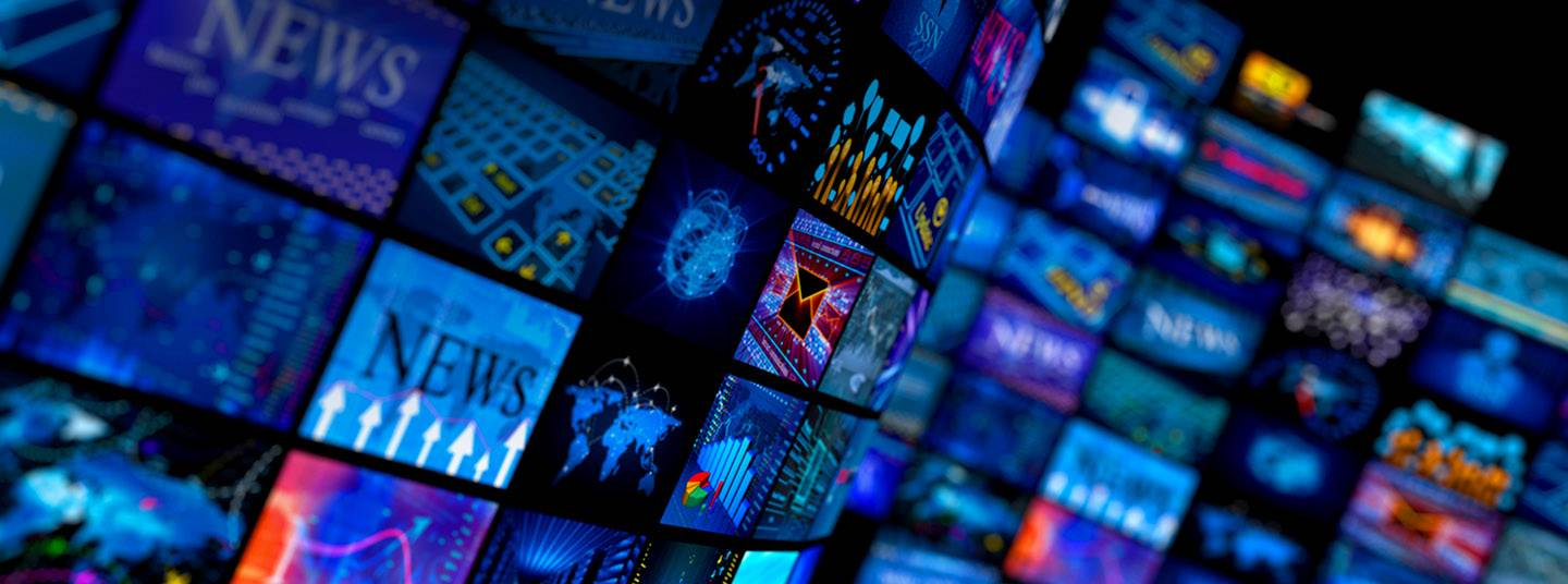 A wall of TV screens, each showing a different image.